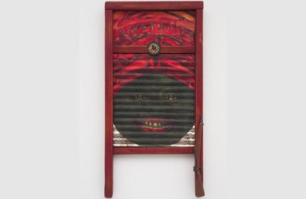 Betye Saar's Liberation, 2011. A washboard with a painted image of a mammie. Exhibition going on during Rare Book Week.