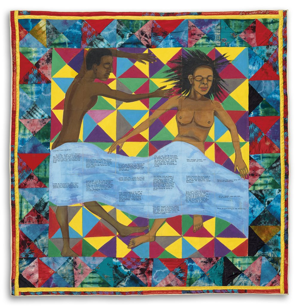 A multicolored quilt with a painting of a sleeping couple on it, with a handwritten story, by Faith Ringgold.