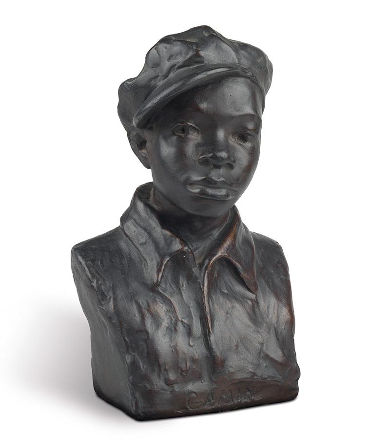 A bust sculpture of a young boy in a news cap.