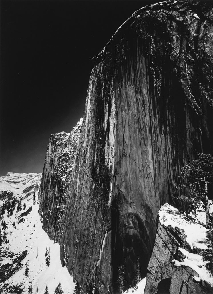 Black and white photograph of a snowy mountainside by Ansel Adams.