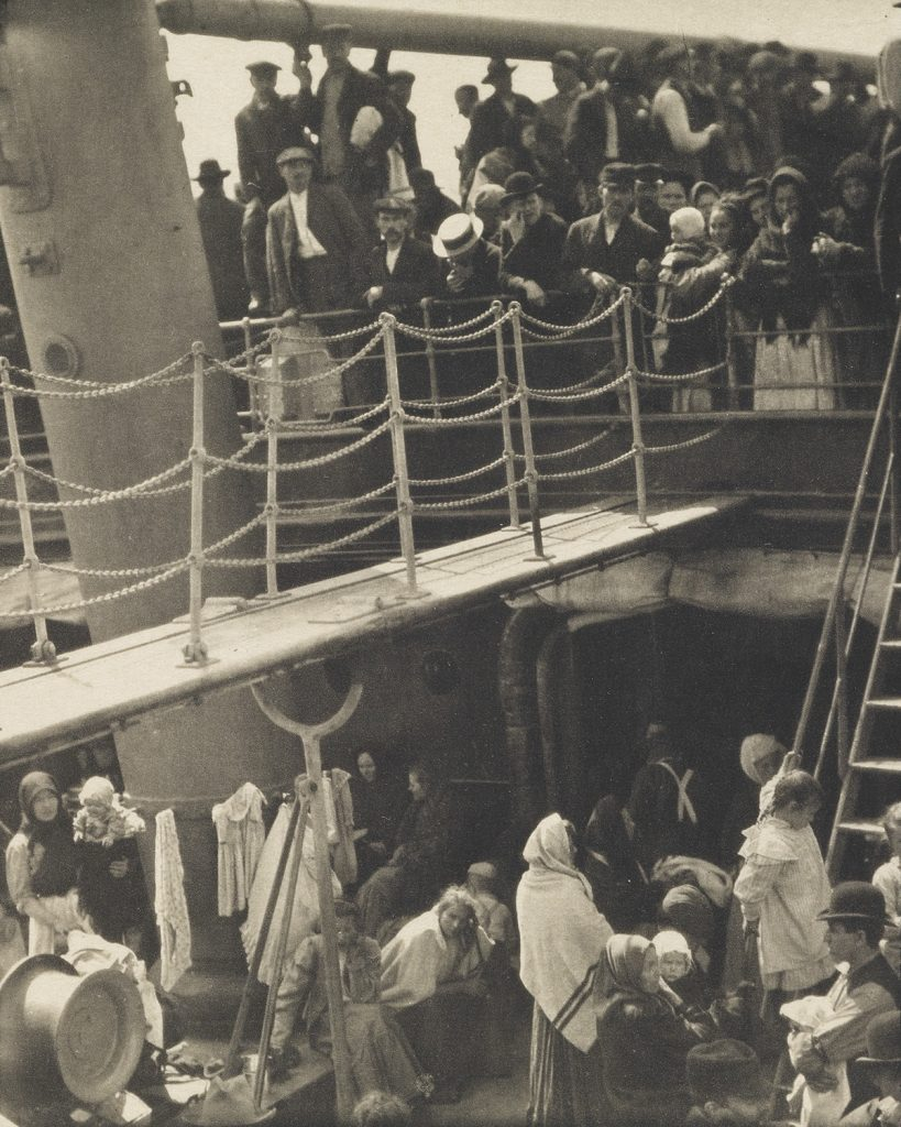 Sepia toned image of immigrants onboard a boat from 1911 by Alfred Stieglitz.