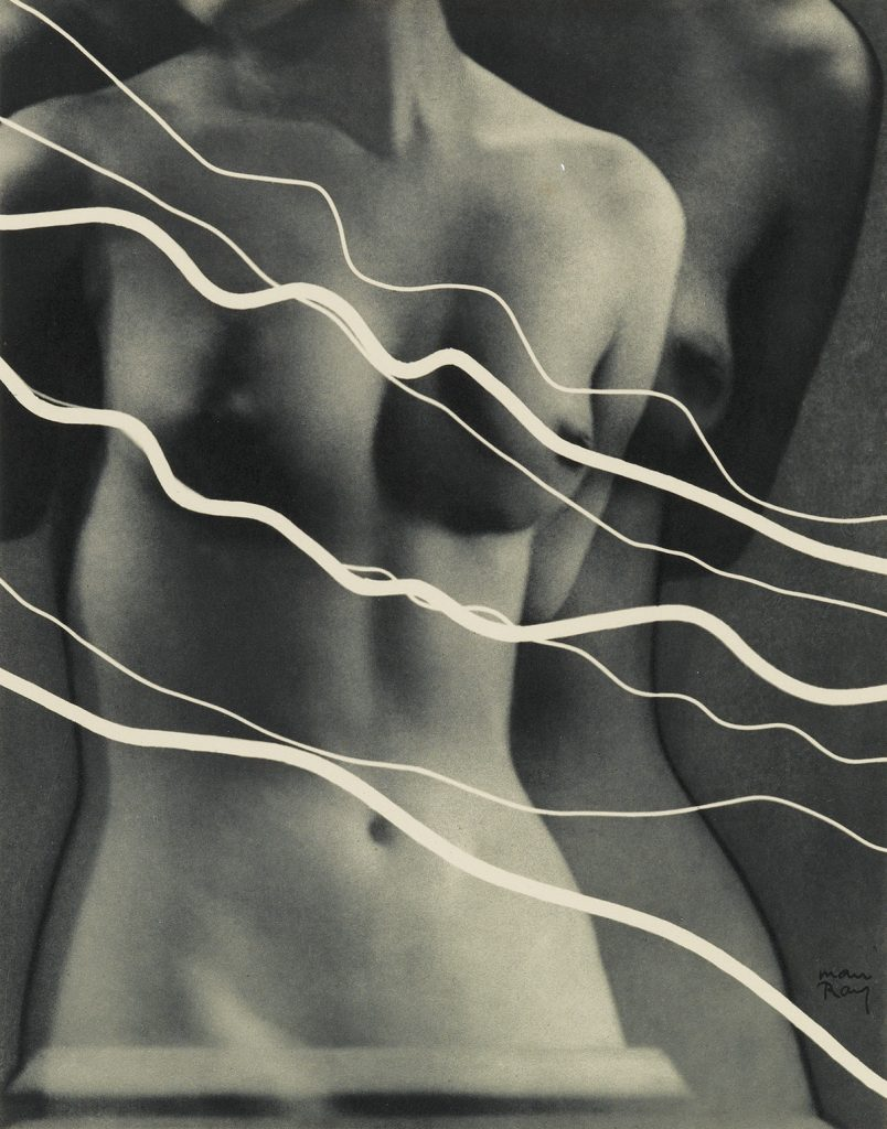 Image of a nude woman with diagonal lines by Man Ray.