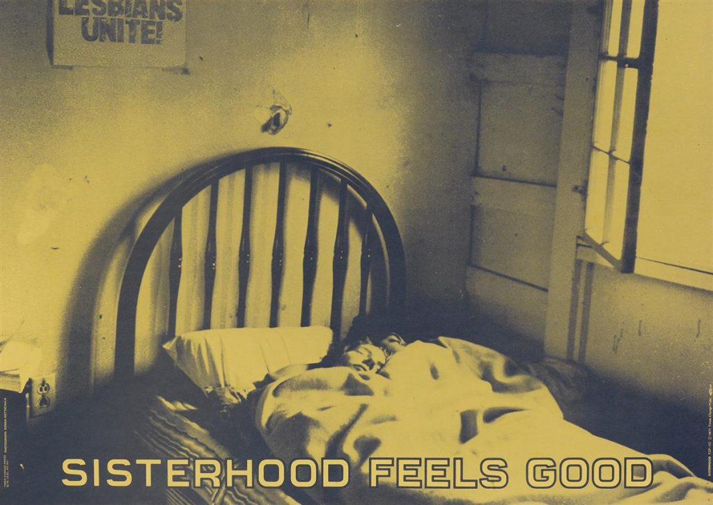 """Green tinted poster of a photograph of two women sleeping in bed with the words """"Sisterhood Feels Good"""" along the bottom. By Donna Gottschalk."""