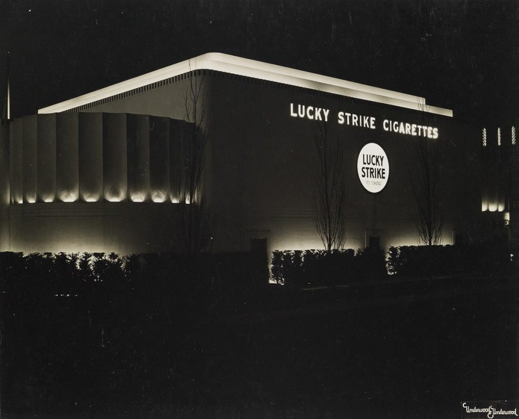 A black and white image of a Lucky Strike Cigarettes factory at night, 1939.
